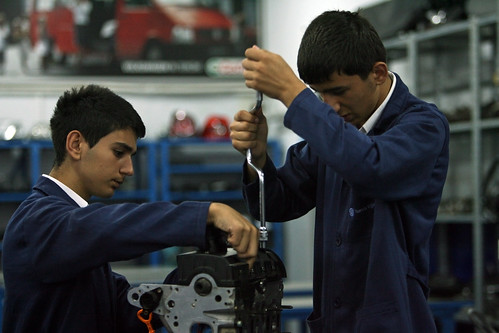 Students work on an engine at Sisli Vocational High School