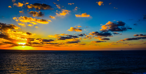 cancún quintanaroo mexico mx caribbean sea sunrise cancun water ocean gulf cove resort hotel vacation morning am dawn clouds yellow orange yucatán yucatan quintana roo riviera maya rivieramaya