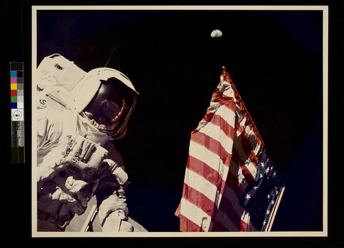 Schmitt with Flag and Earth Above by George Eastman House