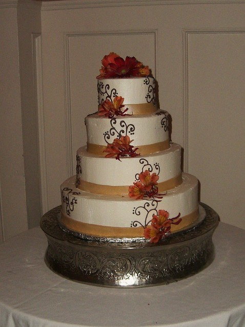 Brown and Gold Wedding 4 tier buttercream covered with chocolate piping and