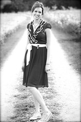 ...a girl in chucks and a dress on a country road