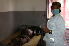 A nurse from Rwanda extracts urine from a patient's bladder  - Natural Fire 10 - US Army Africa - AFRICOM - 091018