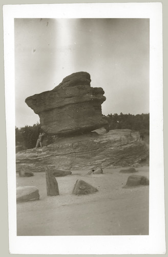 balancing rock being held up