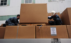 YOKOSUKA, Japan (May 10, 2011) Sailors aboard the aircraft carrier USS George Washington (CVN 73) place more than a dozen boxes of donated blankets onto a flatbed truck outside one of the ship's warehouses. The blankets, donated by George Washington Sailors and their families, were to be delivered to the areas of Japan hit hardest by the 9.0 magnitude earthquake and subsequent tsunami that struck the island nation March 11. (U.S. Navy photo by Mass Communication Specialist 3rd Class Adam K. Thomas)