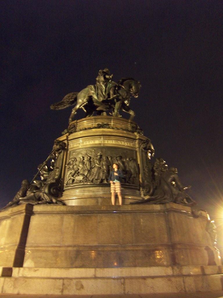 anna climbs the statue