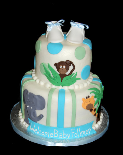Elephant Monkey and Giraffe Jungle themed baby shower cake with baby shoes