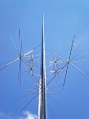 machine(0.0), windmill(0.0), overhead power line(0.0), mill(0.0), mast(0.0), wind(0.0), wind farm(0.0), electricity(0.0), line(1.0), antenna(1.0),