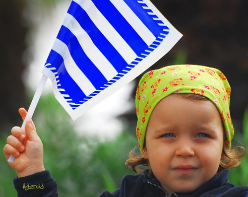 Greek National Day VIII - The flag and the little girl