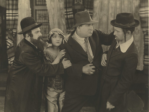 Molly Picon, Sidney Goldin (second right), and Jacob Kalich (far right) in Mezrach und Maarev, 1921