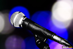 microphone(1.0), purple(1.0), light(1.0), audio equipment(1.0), blue(1.0),