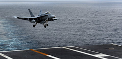 """PACIFIC OCEAN (May 6, 2011) An F/A-18C Hornet from the """"Golden Dragons"""" of Strike Fighter Squadron (VFA) 192 lands on the flight deck during flight operations aboard the Nimitz-class aircraft carrier USS John C. Stennis (CVN 74).  John C. Stennis is participating in a composite training unit exercise off the coast of Southern California. (U.S. Navy photo by Mass Communication Specialist 3rd Class (SW) Kenneth Abbate)"""