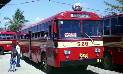 Philippine Rabbit Bus Co Izusu CVE-636 (fleet No 529) with an Almazora body and (fleet Nos 1175, 517) at bus terminal thought to be at Tarlac, Tarlac, Philippines.