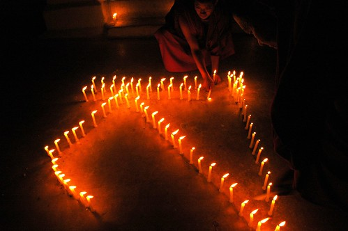 """S"" or ""sa"" in Tibetan spelled out in candles, for Sakya, Sachen Kunga Nyingpo Memorial Day, Boudha Stupa, Boudha, Kathmandu, Nepal"