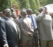 President Mills and other Ghana government officials viewing the scene where the foreign ministry building which was torched recently in the capital of Accra in the west African state. by Pan-African News Wire File Photos
