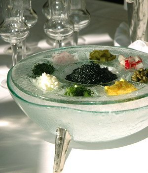Custom made glass ice bowl on foot for caviar service presentation