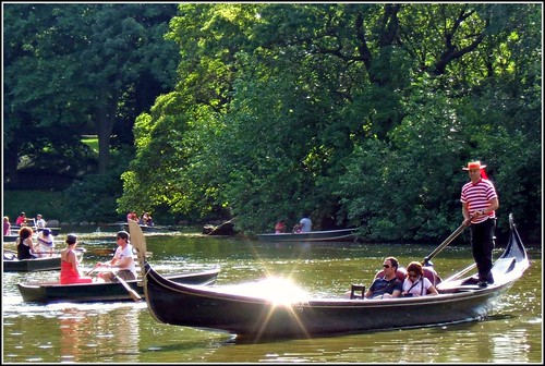People enjoying a boat ride in Central Park