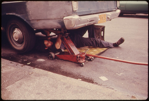 Man Working on Car in Hell's Kitchen, New York City ... 06/1974