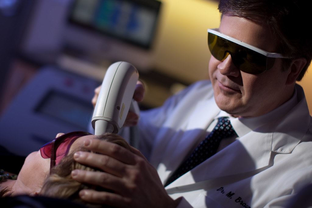 Dr Braun Performing Laser Hair Removal