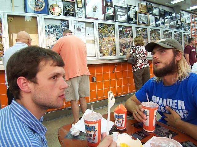 experiencing geno's cheesesteaks & fries