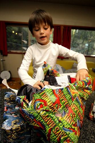 nick unwrapping and modeling gifts from grandma neeta & grandpa jeff