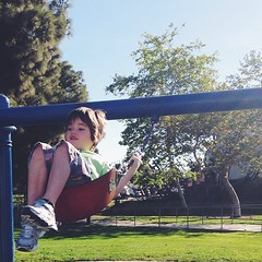 He has learned to #swing at last. #boy #sunlight
