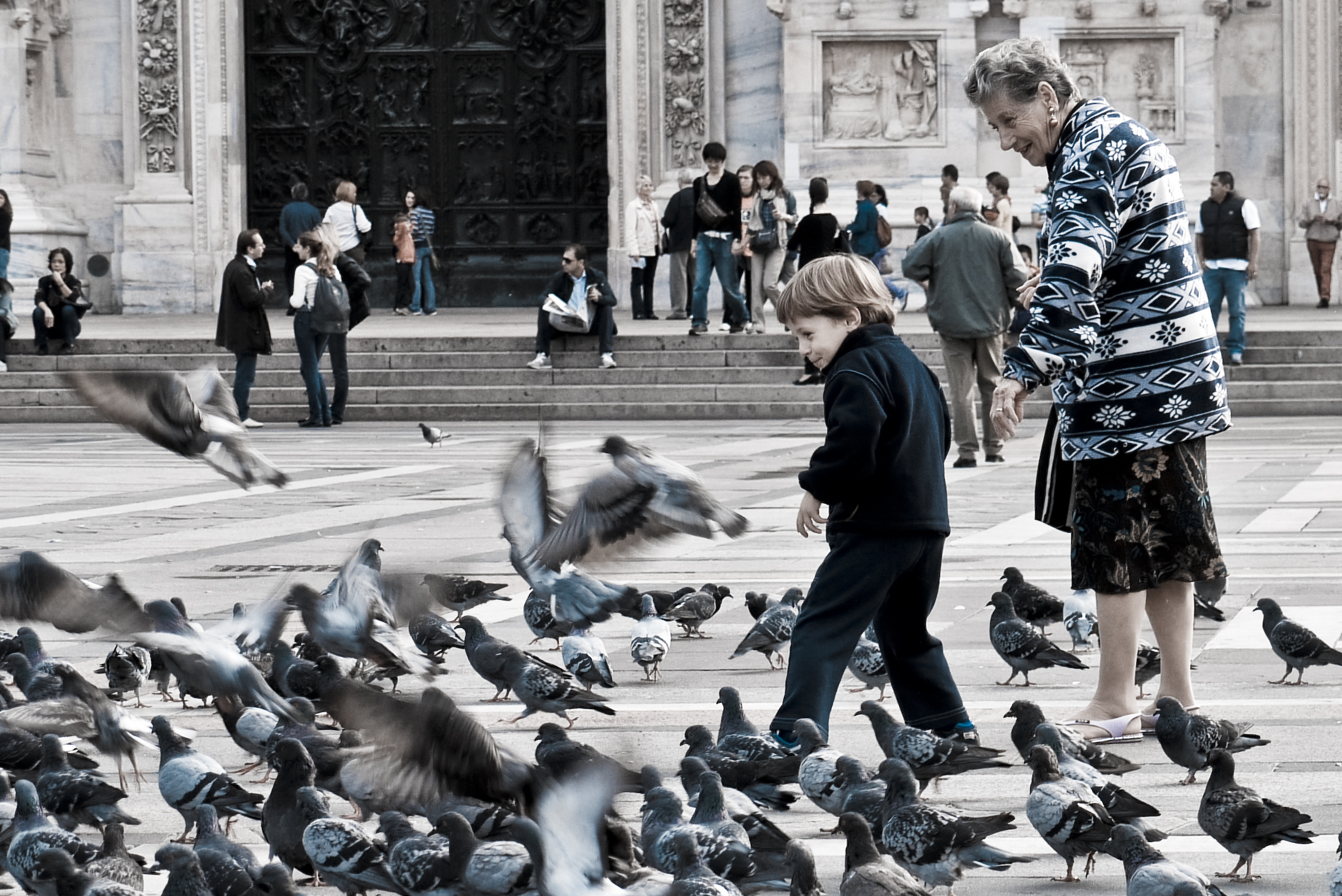 kids and pigeons in Milan, Italy