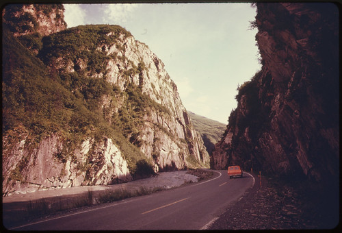 Inside Keystone Canyon, Looking South Along the Richardson Highway. The Cliffs at the Left Climb More Than 1,000 Feet Above the Rushing Waters of the Lowe River. Mile 766, near the Alaska Pipeline Route 08/1974