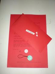 design(0.0), pink(0.0), brand(0.0), art(1.0), envelope(1.0), text(1.0), red(1.0), paper(1.0), illustration(1.0),