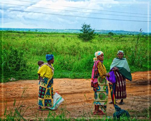 africa green field grass 35mm tanzania women colorful child redclay countryroad morogoro f20 primelens nikond90 texturebygoam travelsofhomerodyssey