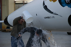 Test pilot Pete Siebold gets a drenching following the Scaled composites 'first flight' tradition. Credit Freddie Weston-Smith
