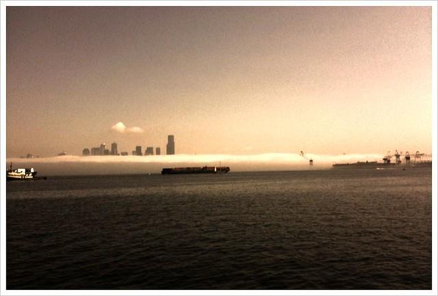 Morning fog crawling it's way south through Elliot Bay, Seattle Washington