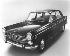 model car(0.0), mercedes-benz w111(0.0), automobile(1.0), automotive exterior(1.0), peugeot(1.0), family car(1.0), vehicle(1.0), peugeot 404(1.0), compact car(1.0), sedan(1.0), classic car(1.0), land vehicle(1.0), luxury vehicle(1.0),