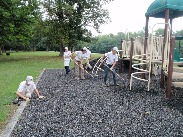 Spreading rubber mulch on playground explore vspycc 39 s - Playground surfaces for home ...