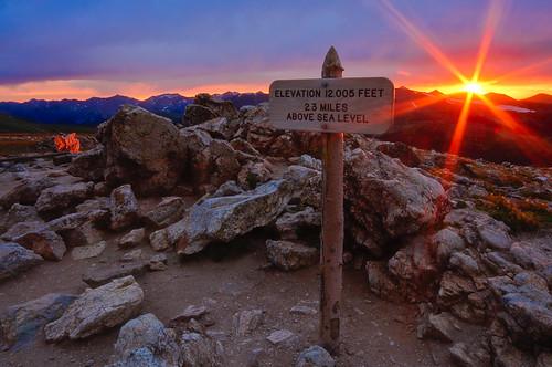 sunset sun snow mountains sign landscape nikon colorado rocks fortcollins boulders rmnp tundra trailridge d90 enfuse