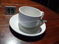 A teacup on table 15,  117