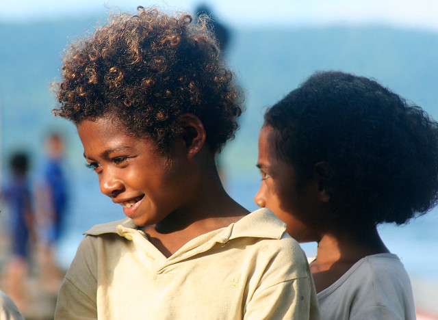 A boy with curly hair in Irian Jaya.