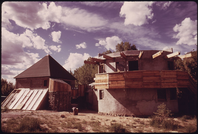 Architect and Experimental House Builder Michael Reynolds Lives in This Structure Which Is a Compendium of His Experiments in the Field, near Taos, New Mexico. the Left Portion of the Structure with the Pyramid-Shaped Roof Has Been Built Using Empty Cans