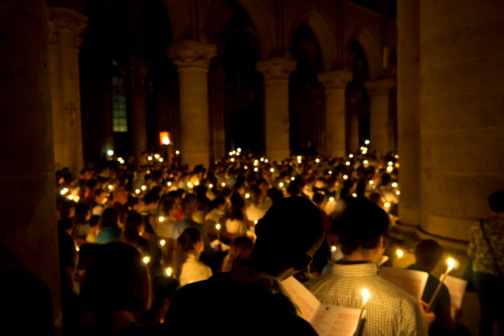 Candlelight Vigil at Notre Dame during Easter in Paris