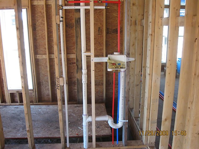 Laundry room rough plumbing flickr photo sharing for New construction plumbing rough in