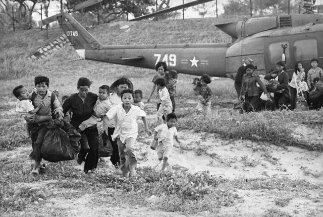 Refugees from the Central Highlands run for rescue helicopters to evacuate them to safety