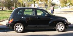 minivan(0.0), compact sport utility vehicle(0.0), automobile(1.0), automotive exterior(1.0), wheel(1.0), vehicle(1.0), chrysler pt cruiser(1.0), city car(1.0), compact car(1.0), chrysler(1.0), land vehicle(1.0),