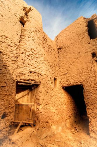 door travel sky stone wall sepia architecture nikon ruins saudi arabia d300 jalajil
