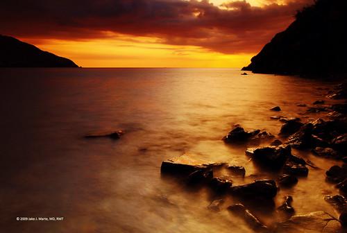 longexposure sunset sea sun beach sanantonio clouds landscape rocks waves cove philippines filters southchinasea philippine zambales explored perfectescapes nagsasa nagsasacove