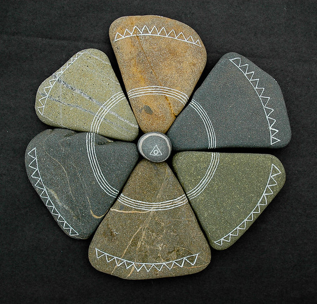 six triangular stones