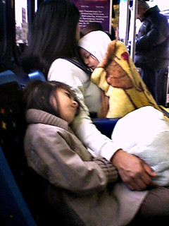 Mother with Two Children (asleep) Riding the Bus