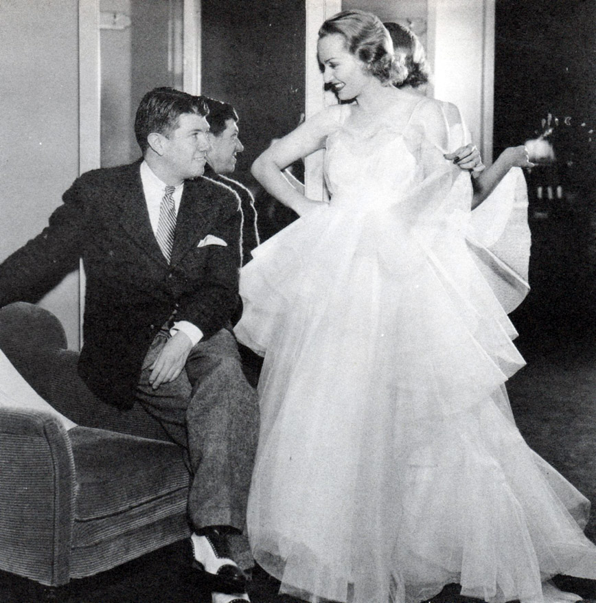 "Carole Lombard and Travis Banton (Designer) in fittings for, ""The Princess Comes Across"", 1936"
