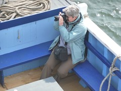 Taking photographs in Seahouses harbour