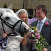 Hungry horse goes for the Bride's bouquet.