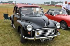 mid-size car(0.0), dkw 3=6(0.0), automobile(1.0), automotive exterior(1.0), vehicle(1.0), morris minor(1.0), antique car(1.0), sedan(1.0), classic car(1.0), vintage car(1.0), land vehicle(1.0),