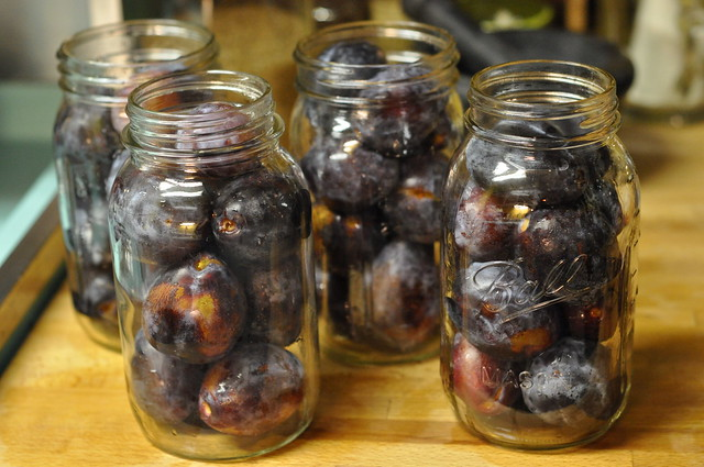 whole plums in jars